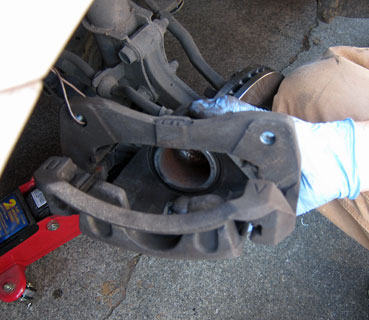 how to change a caliper on a car