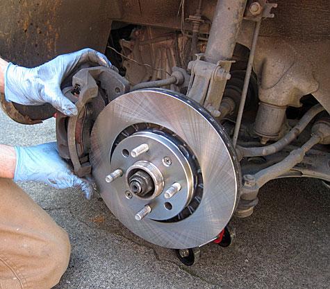 Install Caliper Onto Rotor